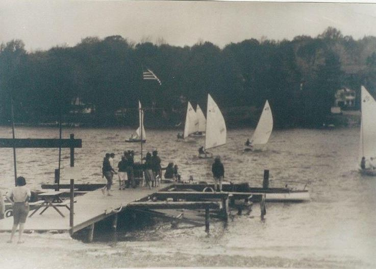 "First dock built by Carl Swanson for $650 in the early 1960s.  Current board member, Dale Campbell, helped Jack Barnes build the sign at the entrance of the dock with ""Harveys Lake Boat Club"" across the top in rope letters."